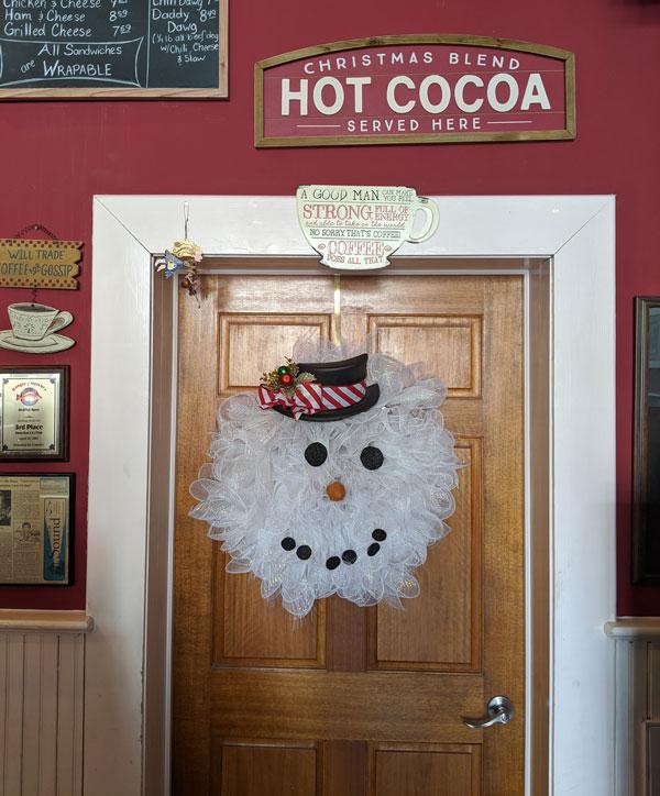 Mr. Snowman wreath on a door